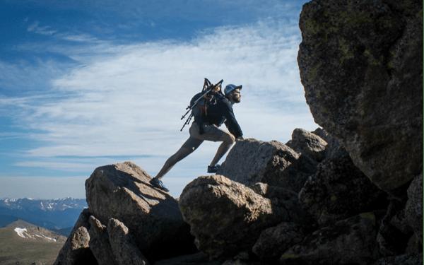 man-rock-climbing-like-executive-team-scaling-up-1